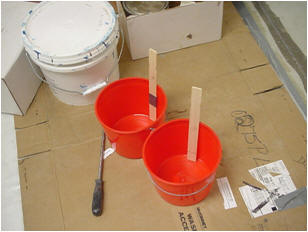 Layout your Epoxy buckets side by side with the measureing sticks in them.