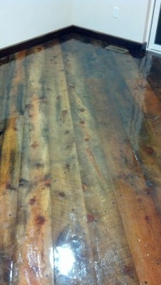Epoxy.com Product #15 Clear Epoxy Top Coating over rough cut reclaimed barn board floor.